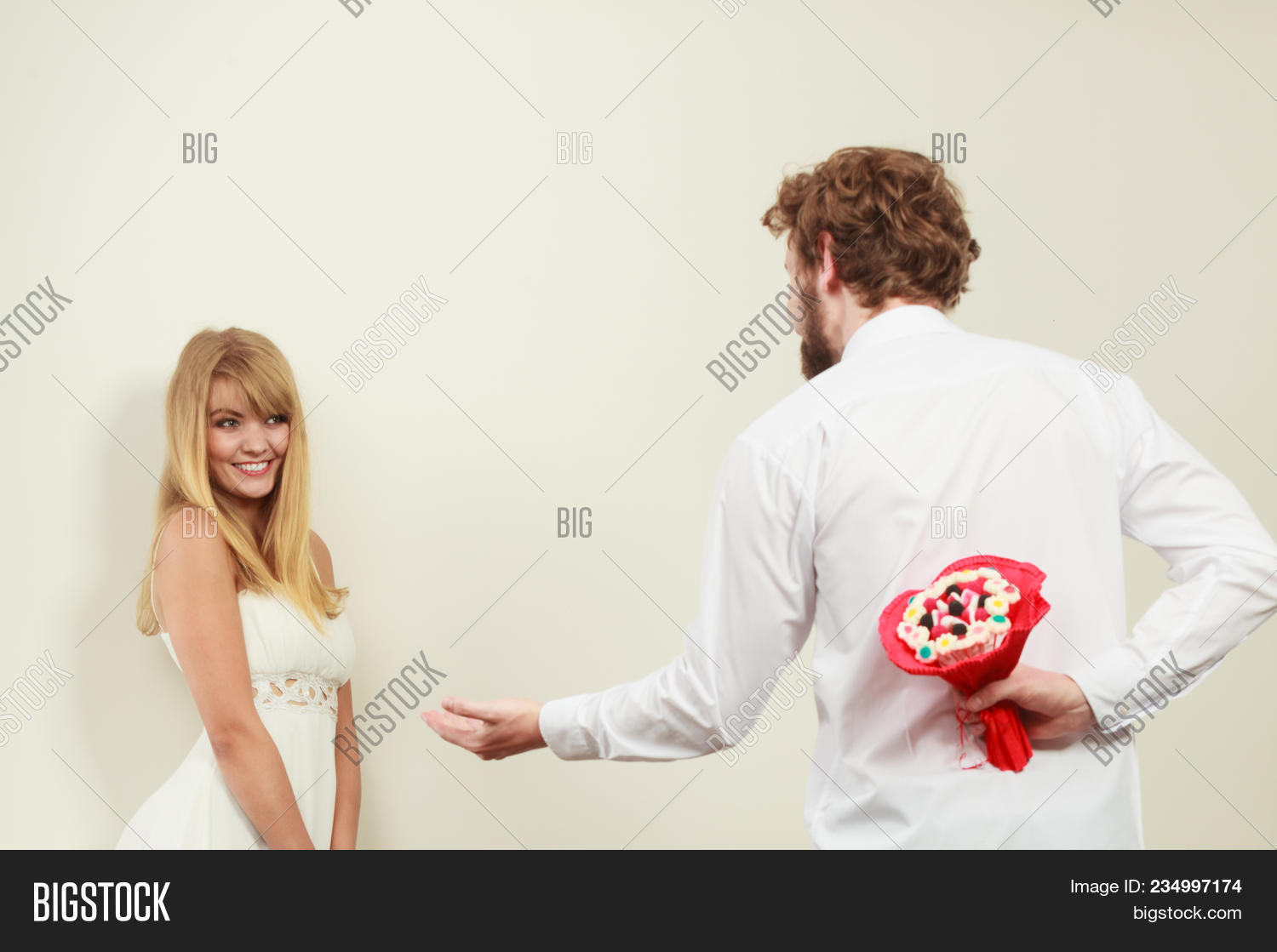 Man holding candy image photo free trial bigstock man holding candy bunch flowers boyfriend with surprise present gift for pretty woman girlfriend mightylinksfo