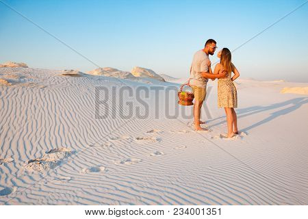 Attractive Couple Kissing On The White Sand Beach Or In The Desert Or In The Sand Dunes, Guy And A G