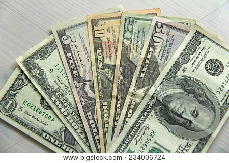 Paper Dollars Of Different Denominations - 1, 2, 5, 10, 20, 50 And 100 Dollars. Background Of Dollar