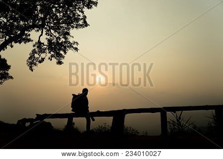 Silhouette Lonely Men Sitting At The View Point Watching The Sunset Go Down In Among The Mountains O