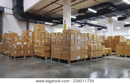 Large Warehouse Logistic Or Distribution Center. Interior Of Warehouse With Rows Of Shelves With Big
