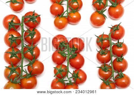 Cherry Tomatoes On A White Background. Horizontal Photo.