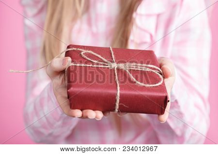 Rad Giftbox In Female Hands In Pink Background