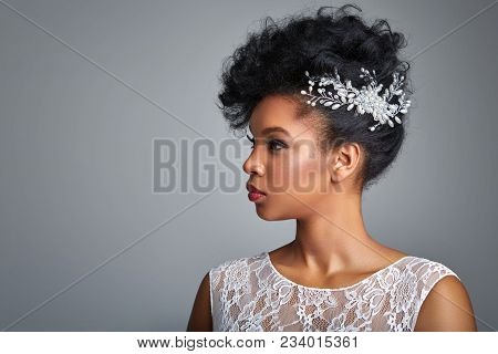 Beautiful Young Woman With Curly Hair And Bridal Makeup. Bride In White Lace Dress.