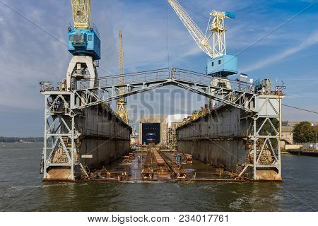 Floating Dock At The Shipyard Is Waiting For A Newly Built Ship
