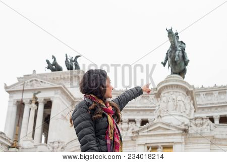 Horizontal Picture Of Long Hair Woman Pointing To Victor Emanuele Monument,  Important Landmark Of R