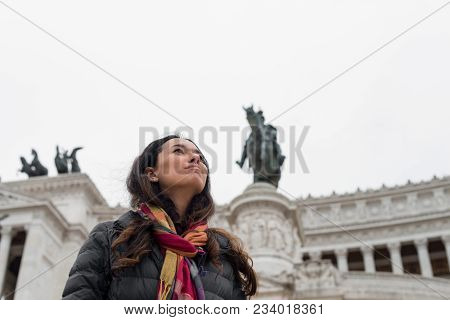 Horizontal Picture Of Long Hair Woman Posing In Front Of Victor Emanuele Monument,  Important Landma