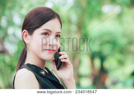 Beautiful Business Smart Look Asian Woman Calling With Smart Phone In The Park