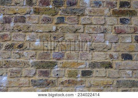Large Expanse Of Yellow Brick Wall.  Great Background Shot.