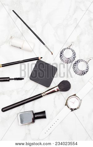 Cosmetics And Accessories Black And White On A Marble Background. Vertical