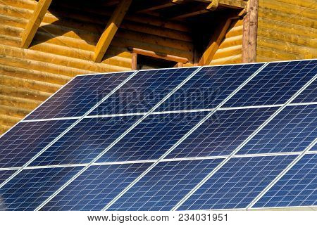 Blue Electric Solar Panels Near Wooden House