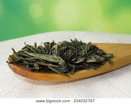 Green Tea. Tea Leaves On Wooden Spoon. Copy Space For Text
