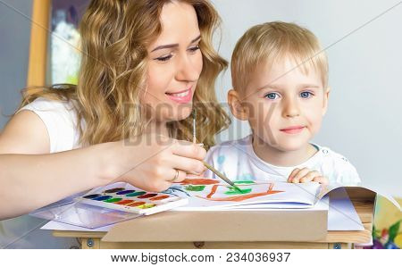 Teaching Drawing And Painting For Children. Art School For Children. A Drawing Teacher Teaches A Lit