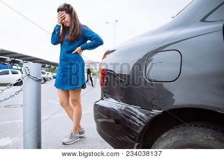 Sad Woman Near Scratched Car. Car Dent. Copy Space.auto Insurance