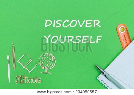 Concept School, Text Discover Yourself, School Supplies, Notebook, Ruler, Pen On Green Backboard