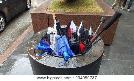 Umbrellas In A Garbage Trash Can Bin Destroyed By High Winds On A Windy Day In The Windy City, Chica