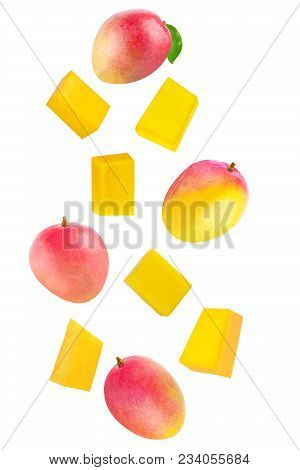 Isolated Flying Fruits. Whole And Cubes Falling Mango Fruit Isolated On White Background With Clippi