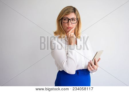 Closeup Portrait Of Suspicious Middle-aged Attractive Fair-haired Woman Looking Away, Thinking And H