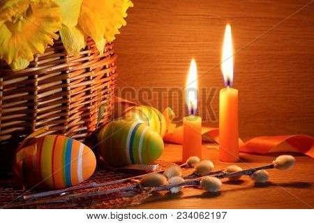 Easter Still Life With Candles. Candles, Easter Eggs And A Basket With Narcissuses.