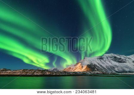 Aurora Borealis. Lofoten Islands, Norway. Aurora. Green Northern Lights. Starry Sky With Polar Light