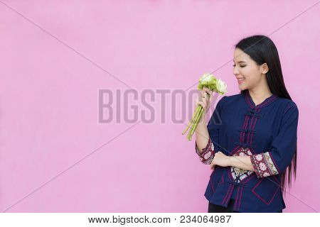 Portrait Beautiful Asian Girl In Traditional Thai Dress And Holding White Lotus Isolated On Pink Bac