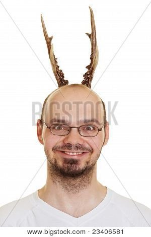 Grining Man With Antlers