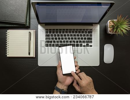 Top View Of Businessman Using Smartphone In Office. Blank Screen Mobile Phone For Graphic Display Mo