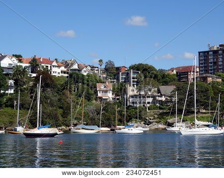 Sydney Harbour, New South Wales, Australia-february 5, 2018:  A Collection Of Yachts At Anchor In A
