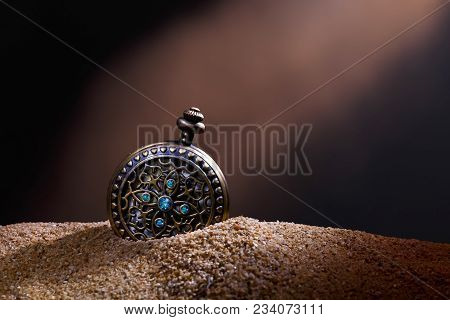 Close Up Luxury Pocket Watch Vintage Style Fashion Shoot On Sand And Blur Background, Lightpainting