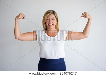 Happy Proud Caucasian Woman In Casual Wear Flexing Biceps. Joyful Female Consumer Advertising Food S