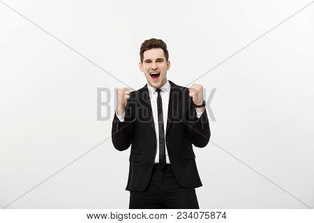 Business Concept: Portrait Handsome Businessman Expressing Surprise And Joy Raising His Hands, Isola