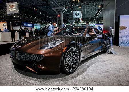 NEW YORK CITY-MARCH 28: 2018 Karma Revero hybrid electric luxury car shown at the New York International Auto Show 2018, at the Jacob Javits Center.