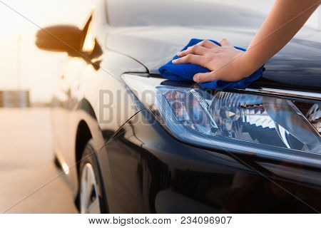 Close-up Portrait Of A Driver Woman Cleaning Her Car With Microfiber Towel.