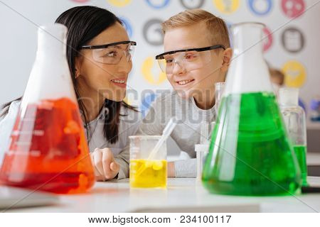 Smart Ideas. The Close Up Of A Pleasant Upbeat Chemistry Teacher And Her Student Discussing The Chem
