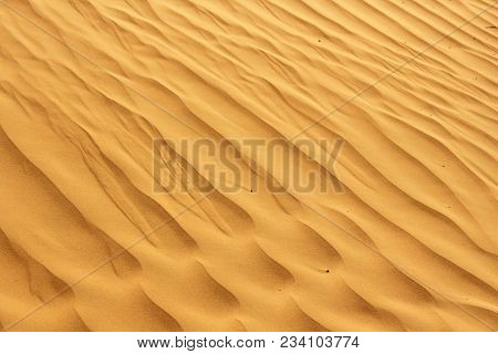 Dunes Of The Desert. Beautiful Wave Patterns Found In A Sand Dune In The Desert. Sand Dunes In The D