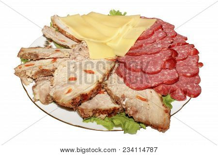 Holiday Meats With Lettuce On A Plate Isolated On White