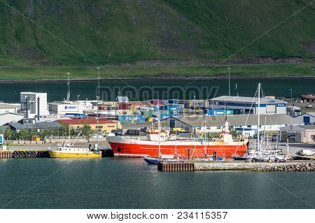 Isafjordur, Iceland - July 7, 2014: Industrial Harbour In Isafjordur, Iceland With A Lot Of Ships An