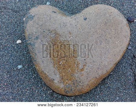 Big Sea Pebble Stone Or Rock In Heart Shape As Frame On Beach. Pebble Stone Heart Natural Abstract T