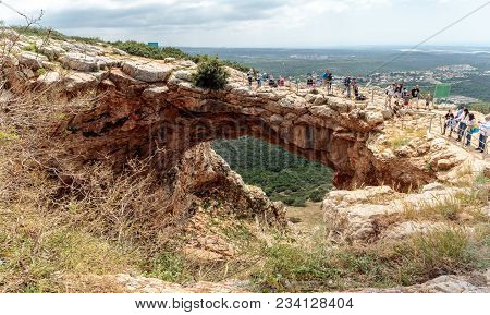 Near Shlomi, Israel, March 31, 2018 : Tourists Stand And Look At The Keshet Cave - Ancient Natural L
