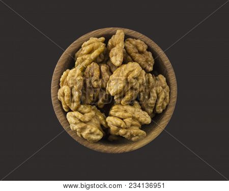 Kernels Walnuts Isolated On Black. Walnuts In A Bowl Isolated On Black Background. Top View. Walnuts