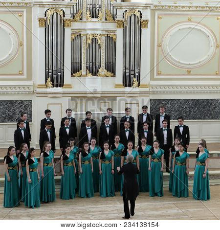 SAINT-PETERSBURG, RUSSIA - FEBRUARY 25, 2018: Youth Choir Alatau of Almaty Music College, Kazakhstan performs during V Children and Youth World Choral Championship. First championship was held in 2011