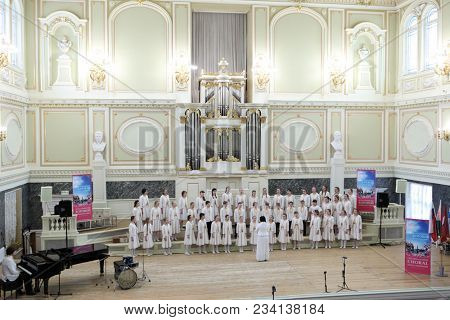 SAINT-PETERSBURG, RUSSIA - FEBRUARY 25, 2018: Children's Choir Little Masters from Moscow, Russia performs during V Children and Youth World Choral Championship. First championship was held in 2011