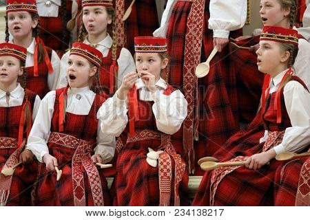 SAINT-PETERSBURG, RUSSIA - FEBRUARY 25, 2018: Children's Choir Lielvarde, Latvia performs during V Children and Youth World Choral Championship. First championship was held in Hong Kong in 2011