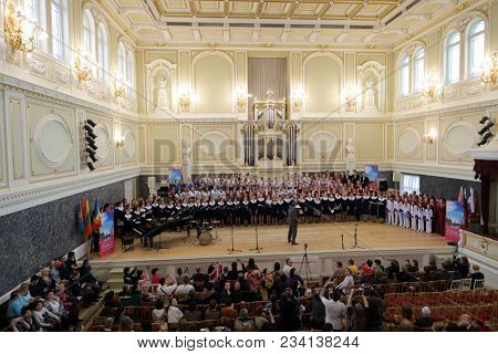 SAINT-PETERSBURG, RUSSIA - FEBRUARY 25, 2018: Combined choir of V Children and Youth World Choral Championship performs in the State Academic Capella. First championship was held in Hong Kong in 2011