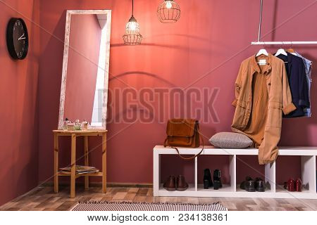 Modern Hallway Interior With Hanging Clothes And Shoe Rack