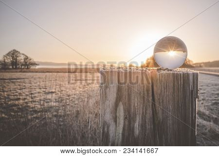 Winter Sunrise With Sun In A Glass Orb On A Cold Morning In The Winter