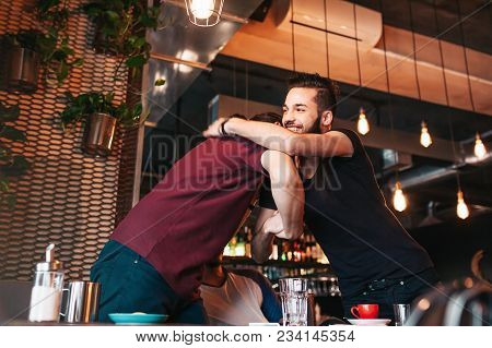 Arabian Young Men Meeting Their Friend In Lounge Cafe. Real Emotions Of Best Friends Happy To See Ea