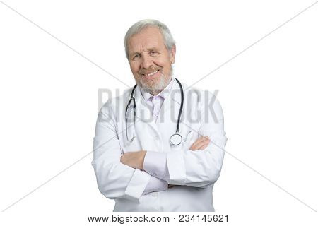 Portrait Of Old Doctor With Folded Arms And Stethoscope. White Isolated Background.