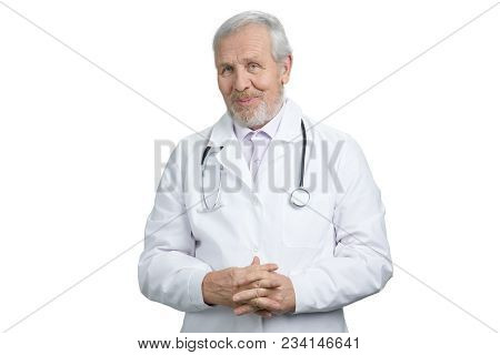 Senior Old Doctor With Folded Hands Portrait. Physician With Stethoscope. White Isolated Background.