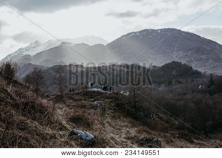 Unidentified People On A Viewing Platform Near Glenfinnan Viaduct, Scotland. The Viaduct Is Featured
